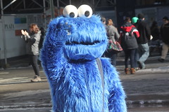 Cookie Monster is either waving hello to a tourist or he's giving a Nazi salute (Hazboy) Tags: street new york city blue schnee winter usa snow cold apple monster america us big cookie manhattan character sesame sneeuw cartoon muppets neve february sn 2013 hazboy hazboy1 snja