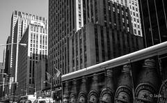 Heineken in NYC (Jack_from_Paris) Tags: life street new york city newyorkcity windows bw usa sun ny holland building beer lines architecture heineken la soleil noir angle time manhattan towers wide security panasonic micro bier monochrom avenue rue et blanc f28 bire 43 graphique p1010647 dmcgf1 pancake14mmf25asph