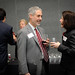 Vice Chancellor for Information Technology Marc Hoit talks with attendees following the summit.