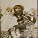 Girl with her beautiful doll, Brighton beach ca 1915