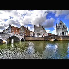 """""""If there is magic on the planet, it is contained in the water."""" -  Loren Eisley (genevieve van doren) Tags: bridge houses sky sun reflection water clouds soleil eau maisons brugge ciel pont bruges nuages quai hdr potterierei"""