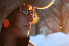 Salt (Blackcatatheart) Tags: winter snow ice sunlight sun golden light lighted lighting glasses moose hat hair caught tree branch bare side profile sideways