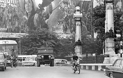 Big movie ad behind Bangkok traffic, 1971 (jackonflickr) Tags: blackandwhite cinema bus movie thailand 1971 theater jeep theatre bangkok ad historic motorcycle facebook notmyphoto 2514