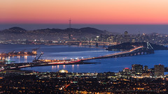San Francisco from Panoramic Hill (Mike Cialowicz) Tags: sf sanfrancisco california ca city longexposure sunset sky urban skyline night docks landscape lights oakland bay berkeley construction nikon cityscape suspension sfo cranes baybridge infrastructure bayarea bluehour shipping 169 span ybi d800 70300 yerbabuenaisland 70300vr