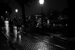 rainy night in Amsterdam (Amselchen) Tags: mono blackandwhite bw lightandshadow light street night amsterdam bike bicycle fuji fujifilm fujinon xt10 xf35mmf14r travel city black
