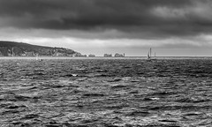 Racing The Storm! (dazzbo1) Tags: wight isle hurst castle lighthouse weather storm waves yaught boat sea sky cloud formation atmosphere wind rain choppy black white mono blackwhite needles coast uk england seascape landscape view atmospheric stormy cliffs chalk