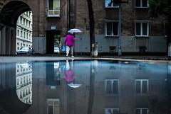 exists (ewitsoe) Tags: nikond80 35mm reflection reflecting krakow nowahuta city woman parasol umbrella lady water rain building communism windows poland polska history cityscape urban citylife life ladies weather summer