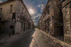 A summer walk in Arachova (Vagelis Pikoulas) Tags: sun sunset sunburst sunshine arachova greece europe 2016 city cityscape canon 6d tokina 1628mm landscape august summer street road building buildings house houses sky blue