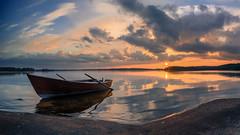 When the weather smiles (Kari Siren) Tags: sun sunset shore cliff isle wooden boat karijarvi jaala
