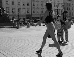Where's my phone? (AndrewTheCandid) Tags: steppingout striding krakow square street poland polska