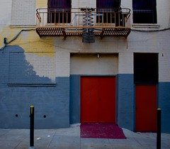 Calico Sidestreet (Zee Jenkins) Tags: sanfrancisco outdoor apartment vanness soma sf yellow blue red door fireescape calico color colors urban architecture