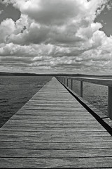long jetty (Justin Mckinney Images) Tags: ocean white lake black water cloudy longjetty