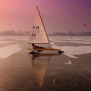 Ice boats are racing at a speed of 100 km over the Gouwsea