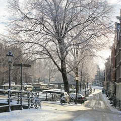 Enjoy the winter magic in Amsterdam (Bn) Tags: world street trees windows winter light sunset people sun seagulls house snow cold holland heritage church water netherlands dutch amsterdam weather bike corner walking frank anne boat canal cozy cool topf50 colorful shadows jan snowy walk seagull sneeuw bikes atmosphere scooter file canals unesco brug snowfall sled mokum rembrandt meeuw meeuwen gezellig cafs jordaan sleding slee bycicle westertoren brouwersgracht nowandthen pakhuis lange noordermarkt westerkerk wester celcius annefrankhuis grachtengordel rondvaartboot 1000km 50faves willemsstraat 1c lekkersluis