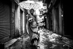 Rainy Day in Parrys (bmahesh) Tags: street people blackandwhite india rain umbrella canon 50mm rainyday streetphotography canon5d chennai mahesh tamilnadu cwc parryscorner parrys indianstreetphotography canoneos5dmarkii chennaiweekendclickers maheshphotography raininchennai bmahesh streetsofparrys wwwmaheshbcom cwc232