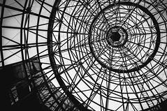 eye (buckyishungry) Tags: blackandwhite white black eye geometric lines architecture shopping point spiral march singapore fuji geometry circles district radiation orchard illusion finepix fujinon concentric radial orchardroad focal radius x100 2013 radii