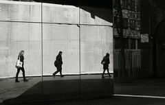 from mirror to mirror to.. (yorktone) Tags: from street camera bridge light shadow two portrait people blackandwhite bw white distortion man black reflection london art monochrome writing dark walking lumix photography one mirror three photo perception women shadows quote decay background candid south perspective streetphotography mirrors cell bank monotone things textures reflected waterloo wisdom g3 cells tone commuters brickwork foreground totality italo calvino reversal divisions striding yorktone