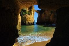 Greetings from Algarve, Portugal (beyondhue) Tags: ocean travel bridge cliff beach portugal rock sand postcard wave sunny scene lagos atlantic shore cave algarve beyondhue