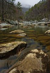 Winter Morning on the Linville River (R. Keith Clontz) Tags: boulders baretrees blueridgemountains linvillegorge clearwater waterreflection appalachianmountains deepwater virginforest northcarolinamountains mossyrocks linvilleriver winterforest matureforest rkeithclontz blueridgepics blueridgelight