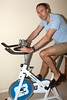 (Jonny Dunbar) Tags: exercisebike terryrichardsoninspired tonto sillypics wearingslippers paleblue shorts ridingabike