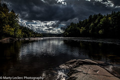 Autumn skies ... (Marty 1955 ...) Tags: outdoors country clouds cloudy stormclouds water waterfront river wakefield trees martyleclercphotography autumn leaves rocks reflections