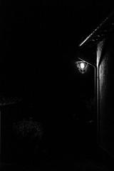 Brighting my way (lorenzoviolone) Tags: agfascala200 bw blackwhite blackandwhite d5200 dslr dark monochrome nikon nikond5200 reflex vsco vscofilm darkness lamp light