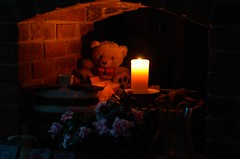 Candlelight reading (Worjohn) Tags: bear christmas light home digital john reading nikon glow teddy image low seasonal decoration cotswolds candlelight bishops cheltenham thompson warming cleeve 7000 worjohn