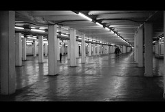 Caring is Creepy (Justin Wolfe) Tags: city light portrait urban blackandwhite bw cinema man cold reflection classic film philadelphia monochrome station silhouette stairs contrast train 35mm vintage dark underground subway concrete person lights hall downtown alone centercity cityhall widescreen bare empty sub under neglected grain rangefinder monotone eerie dirty minimal hallway pa forgotten transportation figure isolation philly grainy ilfordhp5plus400 septa passage cinematic argusc3 concourse argus 215 urbex escalate justinwolfe jwolfe