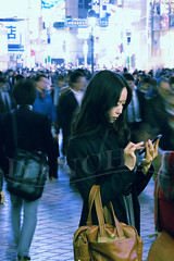 Shibuya - Text (Dan Chui (on/off!)) Tags: street portrait woman motion color fashion japan modern night ads geotagged fun lights tokyo evening cool nikon asia neon technology phone candid text shibuya citylife 85mm cellular style busy  billboards streetphoto   crosswalk cinematic shibuyacrossing d800 scramblecrossing