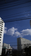 Nagisa New Town Layered Life (jacob schere [in the 03 strategically planning]) Tags: new blue sky cloud building japan clouds digital tokyo town wire skies apartment cloudy jacob 4 communication clear powerlines wires gr lucid iv ricoh edogawa kasai danchi nagisa m2c schere  dgr jacobschere  minamikasai lucidcommunication