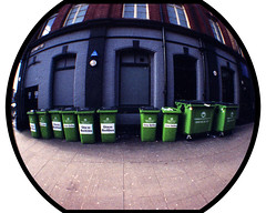 Ten green bottle bins standing against a wall (pho-Tony) Tags: fish color colour green eye film glass analog 35mm toy bottle smash lomo lomography 10 toycamera wide drinking ishootfilm fisheye negative alcohol ten vista analogue 135 agfa recycling bins bulge distort poundland c41 lomofisheye superwide tengreenbottles photosofcameras tetenal lomofisheye2 autaut tengreenbottleshangingonthewall tengreenbottlessittingonthewall andifonegreenbottleshouldaccidentallyfall therellbeninegreenbottlessittingonthewall