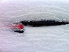 Taillight Under New Snow (AntyDiluvian) Tags: winter snow car boston massachusetts covered melrose coated diggingout coating newsnow