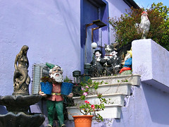 Stairs Worth a Stare (Colorado Sands) Tags: kenmare ireland countykerry sandraleidholdt purplehouse steps figurines irish mermaid troll decorations laurelandhardy planters stairs statues rooster kerry uk gb eire gnome