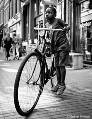 Balancing Act (Bart van Hofwegen) Tags: bicycle boy street bike balance balancing haarlem city portrait streetportrait blackandwhite monochrome leicaq