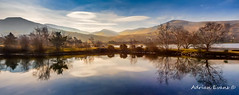 Winter Reflections (Adrian Evans Photography) Tags: winterlandscape scenicview snowdonia landscape winter church llanberis reflection panorama buildings outdoor lake llanberislake lenticularcloud clouds february wales landmark northwales llynpadarn tree uk adrianevans british water sky gwynedd hdr coast ripple mountain 20mm nikon d800 lakepadarn