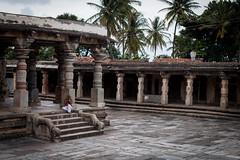 Lonely priest (Scalino) Tags: india karnataka tourism belur halebid halebeed halebeedu hoysala temple carved sculpture priest hindu dark