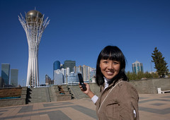 Ethnic Kazakh Girl With Cellphone In Front Of Baiterek Tower, Astana, Kazakhstan (Eric Lafforgue) Tags: plaza people woman building cute monument girl beautiful beauty smile horizontal architecture standing square asian outside outdoors person nice call tour exterior place capital joy cellphone appel mobilephone belle capitale lollipop calling centralasia kazakhstan sourire bonheur humanbeing sights easterneurope gsm batiment hapiness astana asiatique sucette edifice dehors cielbleu beaute waistup vueexterieure appeler telephonemobile etrehumain lookingcamera akmola ethnicalgroup baiterektower cadragealataille audessusdelataille akmolinsk regardantlacamera tourbaiterek bigchupachups ethniekazakhe ethnickazakh kz5050 kazahknationality