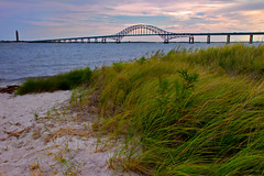 The Bridge to Fire Island (SunnyDazzled) Tags: ocean bridge sea sky tower robert beach water grass clouds landscape island fire sand colorful afternoon wind moses inlet grasses breeze