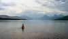 Youth (Spectral Convergence) Tags: boy sky lake mountains water clouds montana glaciernationalpark wading lakemcdonald