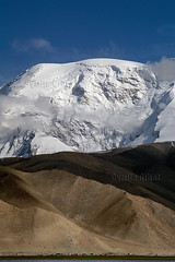 Muztagh Ata (elevation 7,546 m), Xinjiang province, China (Cyrille Gibot) Tags: china horse mountain mountains color colour horizontal landscape plateau xinjiang karakoram tibetan range scenics pamir pamirs sinkiang muztaghata kunlunshan muztagata