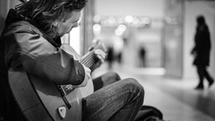 Life in the train station (Giulio Magnifico) Tags: life station train blackwhite bokeh guitar citylife streetphotography 169 guitarist udine nikond800 50mmafsf14g