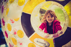 In the hamster ball... (CabDigital) Tags: school red portrait brown sun snow game cute love water girl smile playground yellow kids children fun soap nikon dof child unitedstates florida bokeh naturallight sunny bubbles fortlauderdale browneyes snowday d800 nikkor70200f28vrii