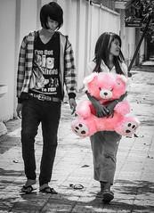 Pink Teddy (daniel.frauchiger) Tags: street pink bw girl lumix couple cambodia teddy panasonic phnompenh selective gf1