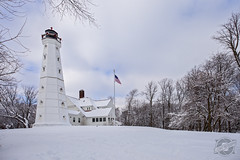 Retired Light (CJ Schmit) Tags: trees winter lighthouse snow wisconsin clouds canon flag milwaukee canonef1740mmf40lusm bluysky 5dmarkii canon5dmarkii cjschmit wwwcjschmitcom cjschmitphotography northpointlightstation