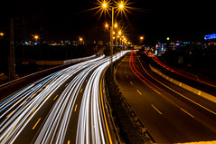 Oneway Traffic (Yam Amir) Tags: road longexposure light urban white cars night contrast dark highway traffic sony sigma route trail f22 brige lightroom lighttrail 30mm nex mirrorless