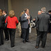 Attendees mingle at the reception following the summit.
