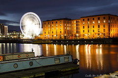 Albert Dock, Liverpool (linda_mcnulty) Tags: uk longexposure reflection building water architecture night liverpool river boat spin houseboat ferriswheel bigwheel barge albertdock rotate merseyside