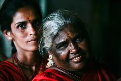 Light on shadow (niledream) Tags: red portrait people india smile women 85mm temples procession madurai tamilnadu pilgrims