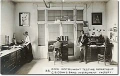 Reed Instrument Testing Department, C. G. Conn Co., Elkhart, Indiana (Hoosier Recollections) Tags: people music woman usa signs man men history buildings advertising clothing women factory workmen indiana elkhart businesses realphoto elkhartcounty hoosierrecollections