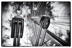 Ropes and masts (Cristo Bolaos) Tags: sea sky blackandwhite blancoynegro clouds mar barco ship flag cielo nubes bandera ropes masts cabos mstiles mstil